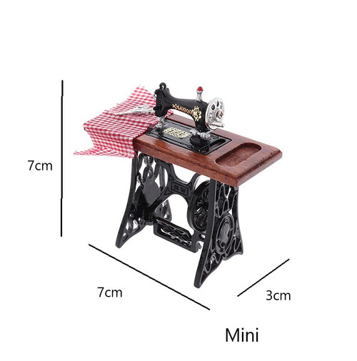 MINI RETRO SMALL BLACK TREADLE SEWING MACHINE ON A WOODEN BENCH