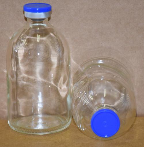 100 mL Clear Sterile Vial w/ Medium Blue Aluminum Plain Flip Cap Seal 52mm X 95mm