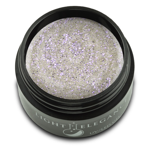 A fine and seriously sexy white-gold glitter with opaque coverage and smooth, easy application. This shade can be combined with countless other colors, endless nail designs and almost any look, making Oopsie Daisy a sure, dazzling staple in your collection. The ultimate party glitter.  UV/LED Glitter Gel, Oopsie Daisy, 17 ml  Coverage: Opaque Effect: Glitter