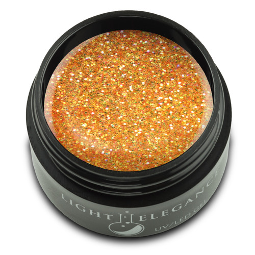 This fiery glitter gel has flashes of orange, yellow, and peach. It's as hot and bright as the flame of a fire!   UV/LED Glitter Gel, Nice Melons, 17 ml  Coverage: Opaque Effect: Glitter