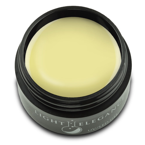 A soft, baby yellow with a lot of white for rich, opaque coverage that allows even this soft yellow to make a statement this season.   Sunkissed UV/LED Color Gel, 17 ml  Coverage: Opaque Effect: Flat/Cream