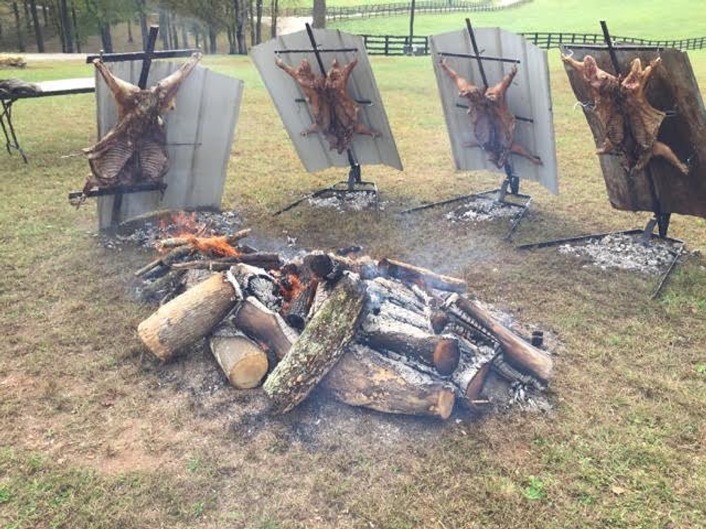 Asado Cross with Adjustable Base Whole Animal Barbeque pictures.