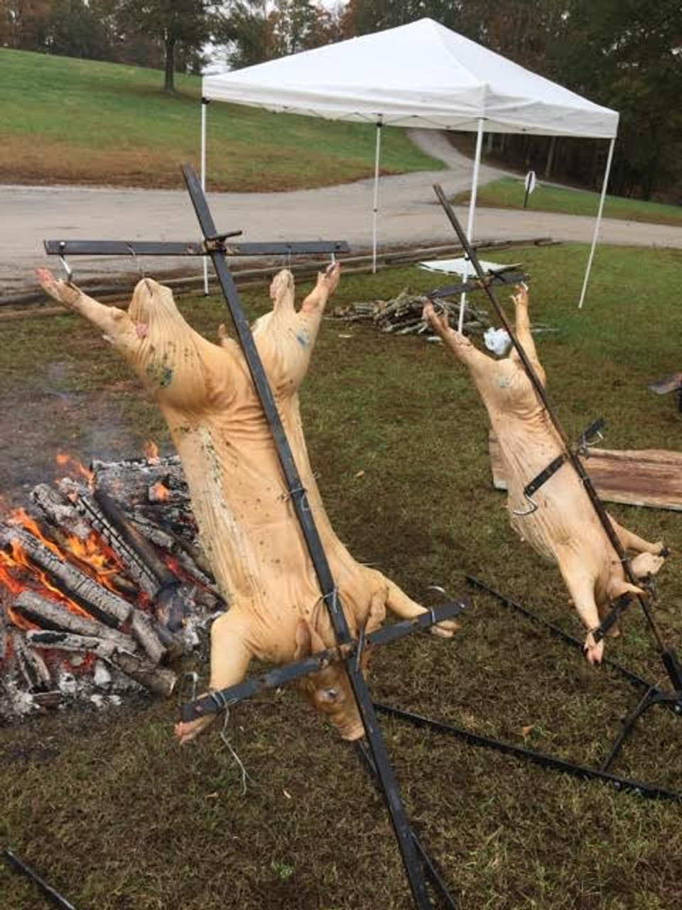 Asado Cross with Adjustable Base Whole Hog Barbeque pictures.