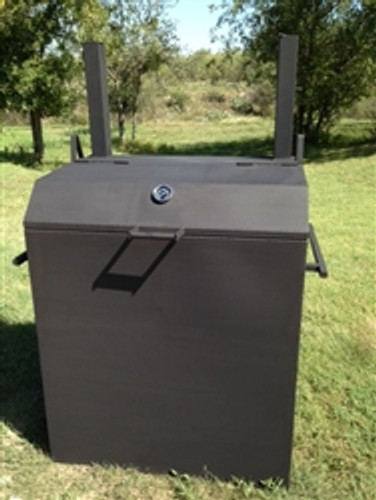 Authentic Country Themed Texas BBQ Pit Smoker made from rustic black steel with  an earthen floor.