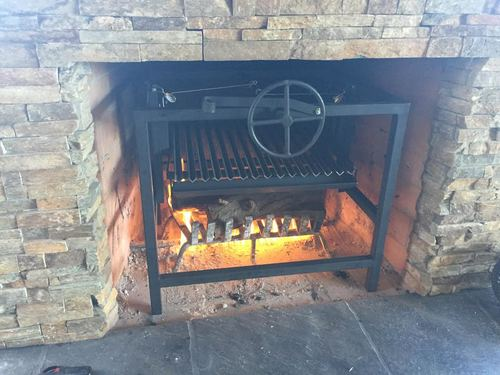 A Chimney Fireplace Grill tranforming your fireplace into a work of art and convenient way to cook Asado.