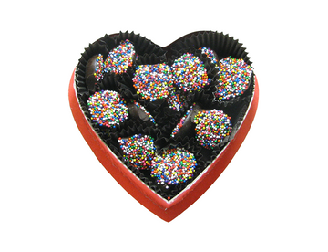 Solid chocolate drops with rainbow-colored sprinkles weighing 4 ounces.  Crunchy and chocolatey!