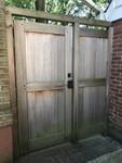 Bronze double cylinder deadbolt on cedar gate
