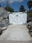 Outswinging driveway gate with heavy duty bronze strap hinges 20-324 and 50-50