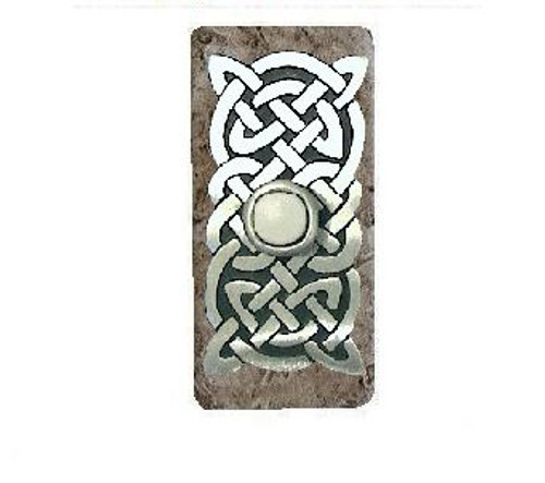 Celtic Knot Lighted Doorbell Button in Pewter with Narrow Orientation on Dark Travertine