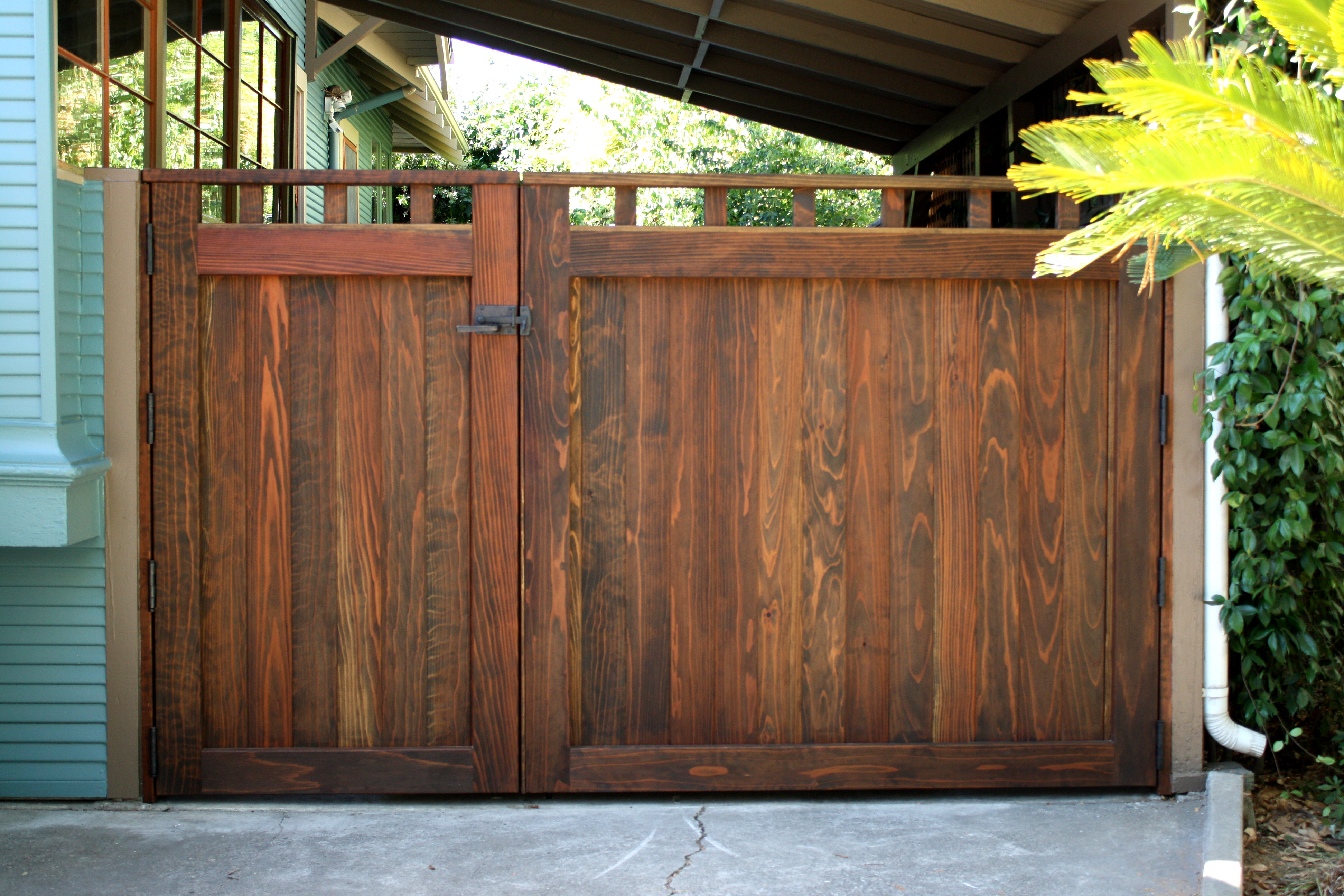 double-wood-driveway-courtyard-gate-in-craftsman-style.jpg