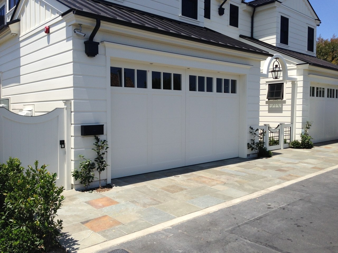 Modern gate hardware package with tapered ring installed on gate installed street view