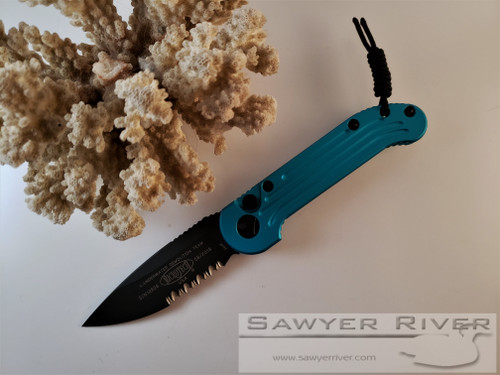 MICROTECH L.U.D.T. BLACK SERRATED BLADE TURQUOISE HANDLE (CORAL NOT INCLUDED)