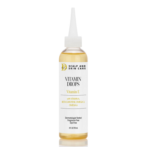 A bottle of Design Essentials Scalp & Skin Care Vitamin Drops