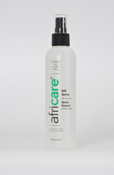 An 8oz bottle of Africare Silk Spray with Jojoba Oil