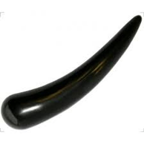 gua sha made of ox horn with pointed end for acupressure and massage