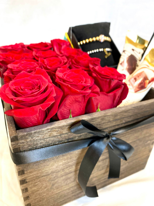 Your choice of one dozen red roses uniquely placed in a box.