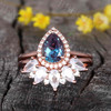 pear shaped alexandrite engagement ring and moissanite wedding band