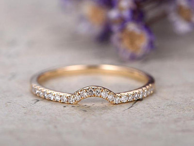 Curved diamond wedding band yellow gold