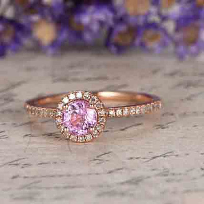 Pink sapphire engagement ring with diamond halo 0