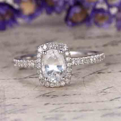 white Sapphire engagement ring with Diamond halo 0