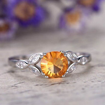 Yellow citrine engagement ring with topaz 0