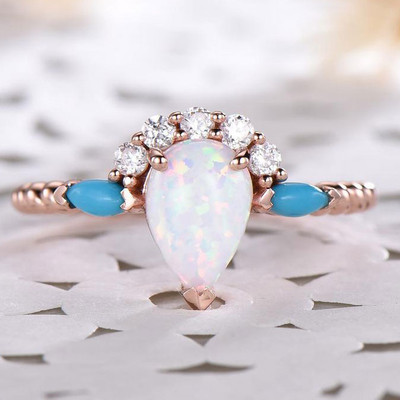 Pear shaped moonstone engagement ring and turquoise
