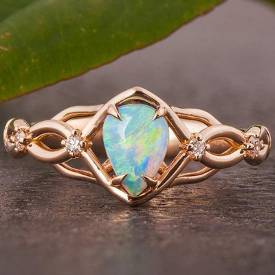 Australian opals Celtic style engagement ring