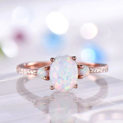 Three Stones Design Opal Engagement Ring