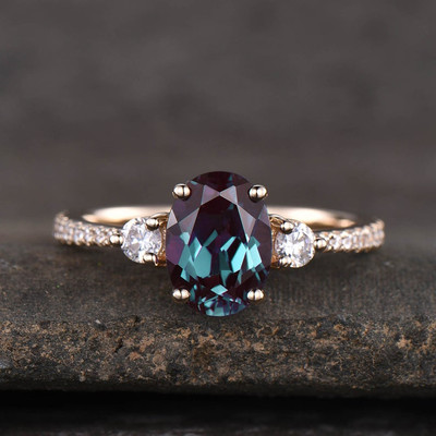 three stone alexandrite engagement ring yellow gold