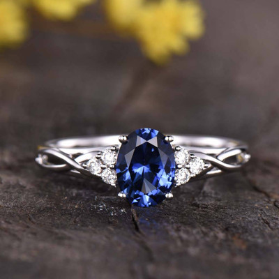 Cluster Blue Oval Cut Sapphire And Diamond Engagement Ring 0