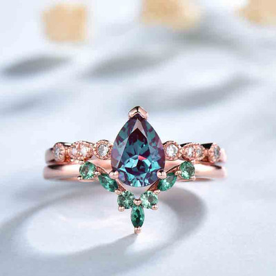 Pear alexandrite diamond ring and emerald wedding band rose gold 0