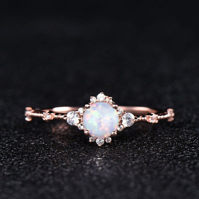 Dainty opal engagement ring