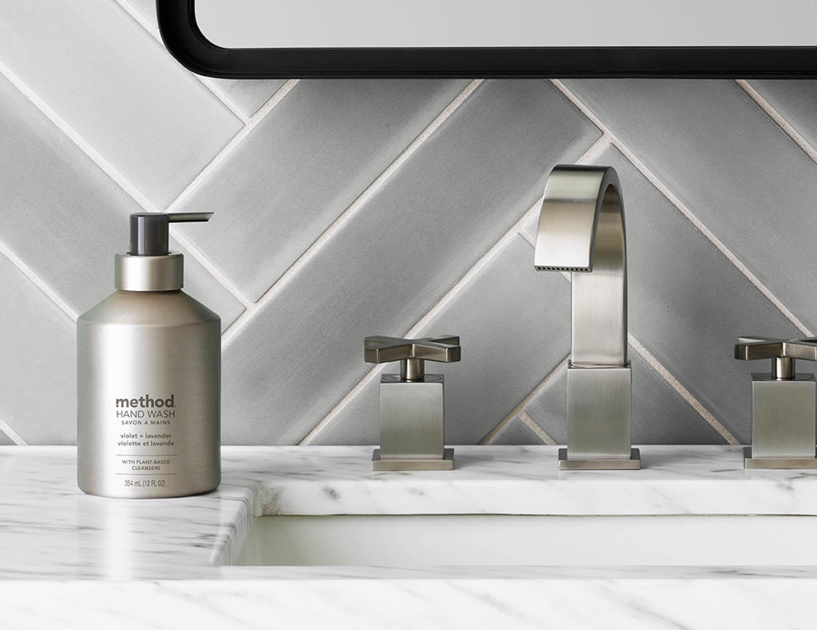 Washing hands with Method aluminum Vanilla + Raspberry soap