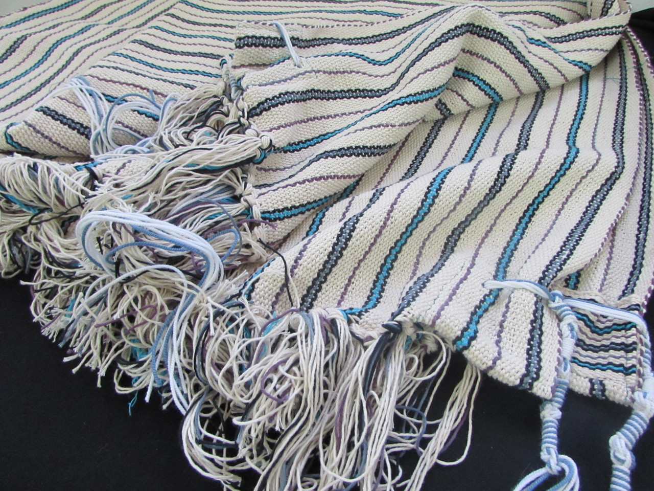 Shown with techelet tzitzit (Raavad tying)
