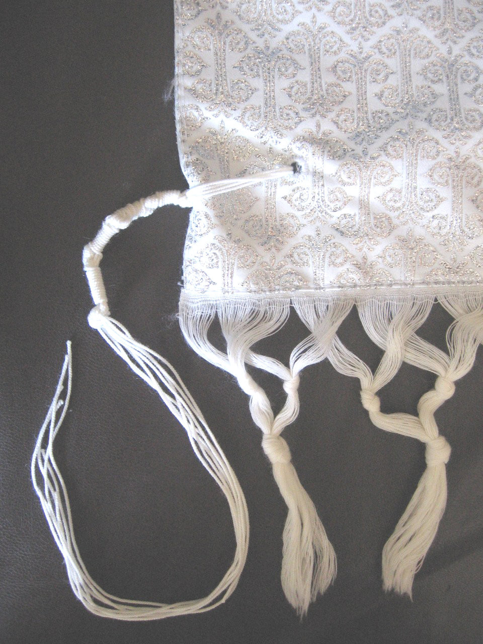 Silver embroidery on the corners
