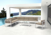 Golden Beach Chaise RHF: As shown entire collection with bright white galvanized aluminum frame and taupe cushions, white beach coffee table and armed chair (front view)
