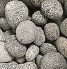 Warming Trends Smoothed Black and Gray Lava Fire Pit Rocks: As shown black and gray smooth rolled lava rocks in shapes 1 - 2 inches diameters.