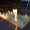 "Elements-Fire-Glass-Teal 1 -1/2"": Product photo in outdoor fire pit."