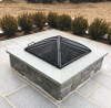 low-profile fire pit spark screen: Ash shown on top of wood burning fire pit with the carbon black steel finish and one panel access door.