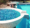 Blue Luster Jelly Bean Fire Pit Glass- As shown in concrete fire bowl pool side.