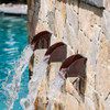 Bobe Radius Scupper: As shown copper patina radius scuppers with water spilling into pool