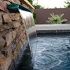 Bobe Water and Fire Smooth Flow Scupper:  Smoother Flow Scupper shown with the smooth copper with a patina finish, water spilling down into the pool below.