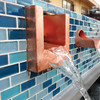 Bobe U-Shape Copper Scupper: As shown in the polished copper finish with water dripping down into the pool below.
