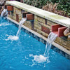 Bobe U-Shape Copper Scupper: As shown with a patina copper finish with water flowing down into the pool below.