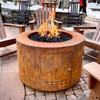 Beverly Round Fire Pit by The Outdoor Plus: 30 inch Diameter Fire Pit shown in the corten rust finish.