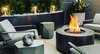 Cylinder Gas Fire Pit- Shown in Aluminum with a Hammered Bronze Powder Coat Finish and Black Lava Rocks