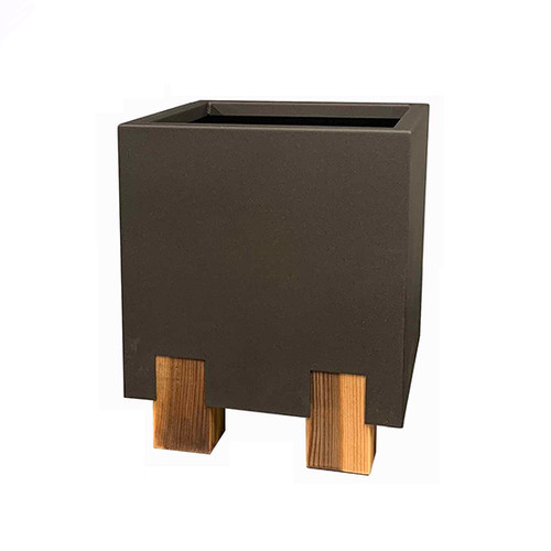 Stilt Planter By Yard Couture: As shown in the powder coated textured bronze finish with stained cedar legs.