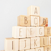 Close up of Page and Pine Raw Alphabet Blocks