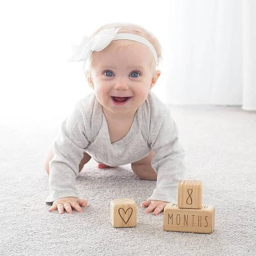 Page and Pine Original Milestone Blocks - 8 month old baby.