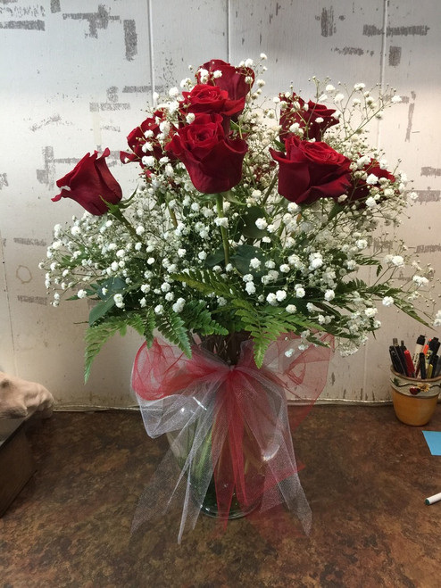 Show your love with 9 red roses in a sea of babies breath
